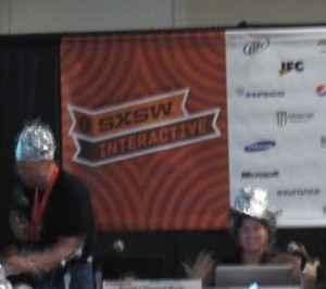 Panelists looking towards the future wearing hats made of tin foil