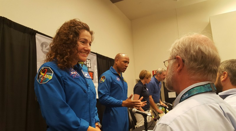 Astronauts Jessica Meir and Victor Glover talk to interested audience members.