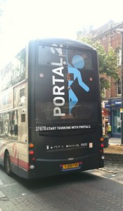 Game advertising is extensive, visible here in an ad for Portal 2 on the back of a bus.